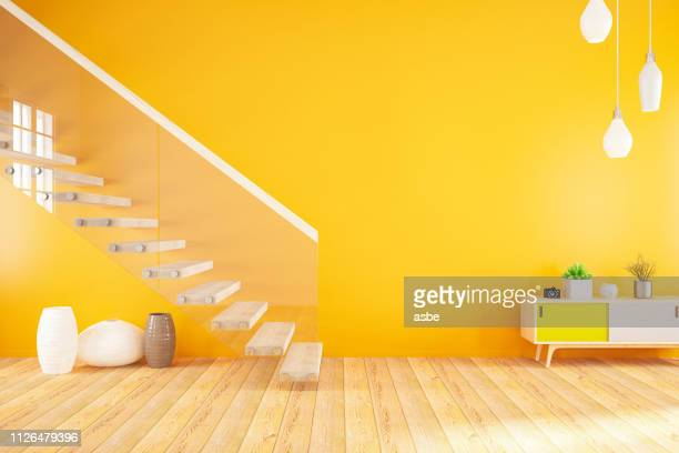 empty modern orange interior with stairs - yellow stock pictures, royalty-free photos & images