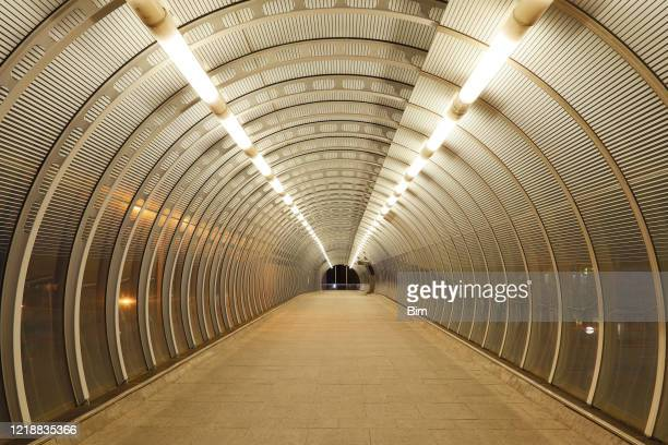 empty modern tunnel in london, covid-19 effect - the way forward stock pictures, royalty-free photos & images