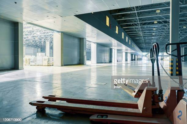 empty modern warehouse - storage compartment stock pictures, royalty-free photos & images