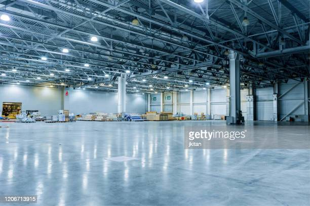 empty modern warehouse - industry stock pictures, royalty-free photos & images