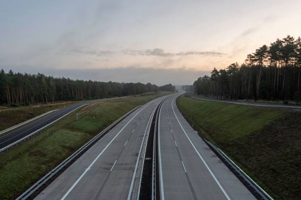 Empty motorway to sunrise, motorway 14, upgraded section, Colbitz, Saxony-Anhalt, Germany