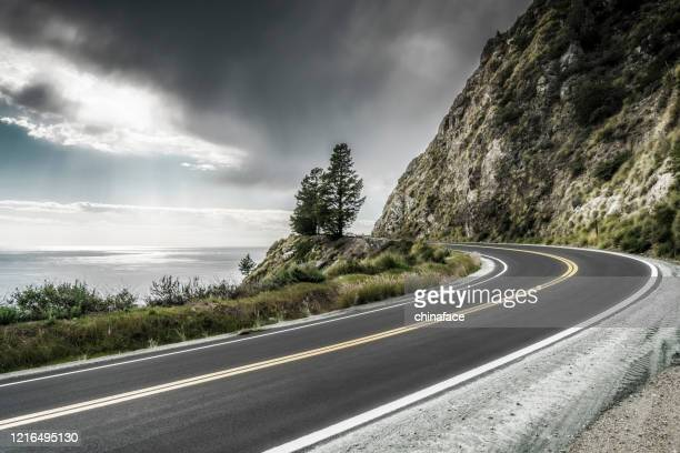 empty mountain highway in california - two lane highway stock pictures, royalty-free photos & images