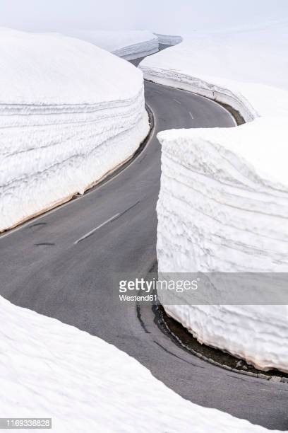 empty mountain pass road in winter, timmelsjoch, tyrol, austria - mountain pass stock pictures, royalty-free photos & images