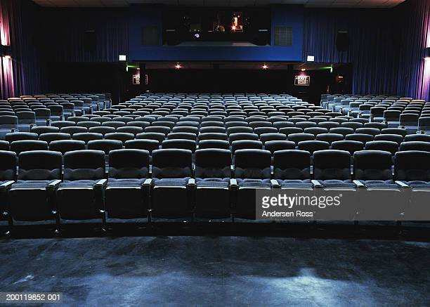 empty movie theater - seat stock pictures, royalty-free photos & images