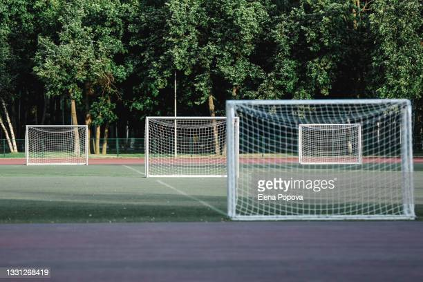 empty multi-goal soccer field for school training - audience free event stock pictures, royalty-free photos & images