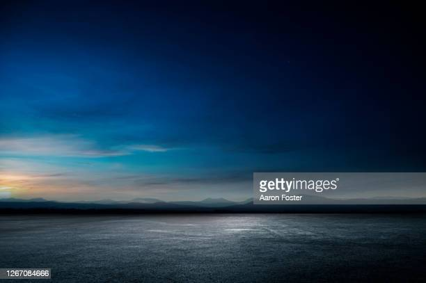 empty night parking lot - empty lot night stock pictures, royalty-free photos & images