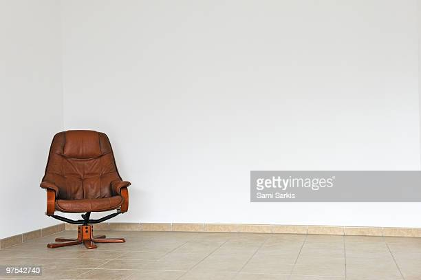 Empty office chair in empty room