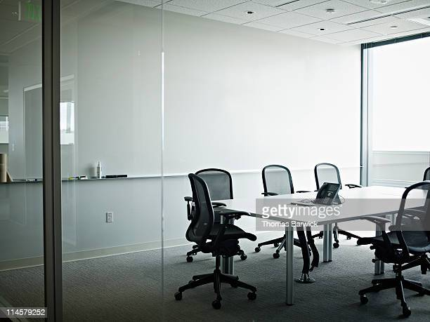 empty office conference room with phone on table - 会議施設 ストックフォトと画像