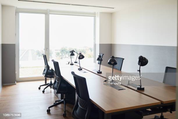empty office space. - empty desk stock pictures, royalty-free photos & images