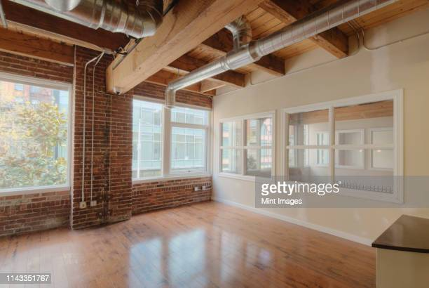 empty office space - ceiling stock pictures, royalty-free photos & images