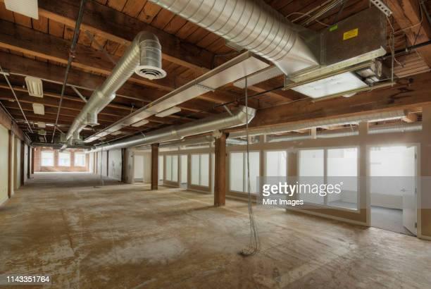 empty office space under construction - 不在 ストックフォトと画像