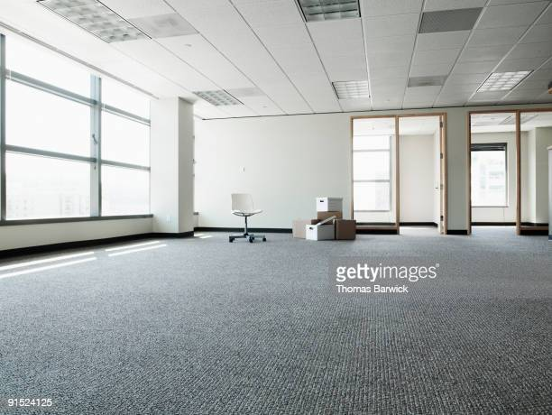 empty office with boxes and one chair - abandoned stock pictures, royalty-free photos & images