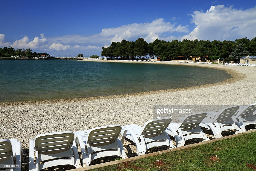 Empty off-season beach on sunny spring day : Stock Photo