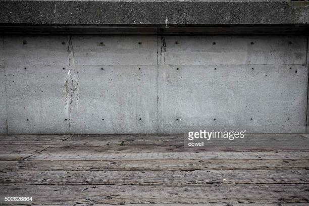 empty old wooden floor front of concrete wall of business building