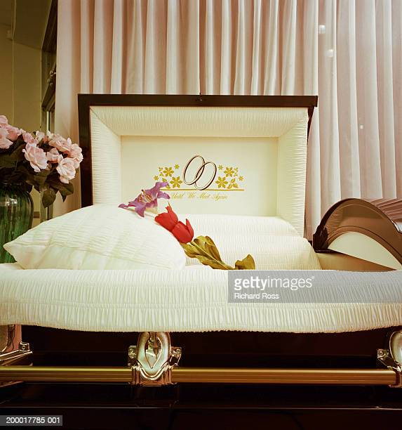 Empty open casket being displayed
