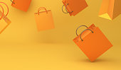 Empty orange color shopping bag on the yellow background, copy space text, Design creative concept for halloween day or autumn sale event.