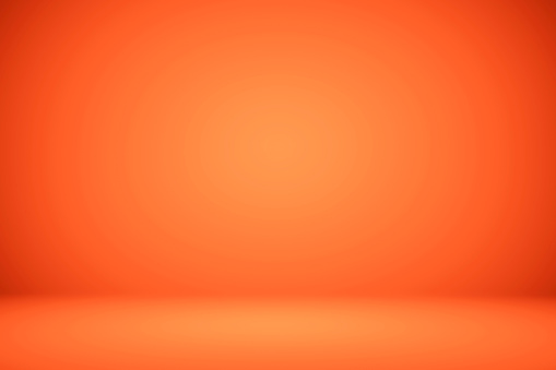 Empty orange studio room, used as background for display your products 1150321372