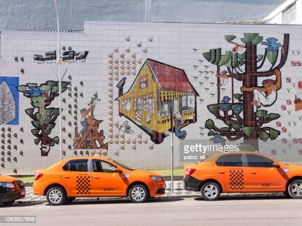 empty orange taxi line curitiba paraná - curitiba stock pictures, royalty-free photos & images