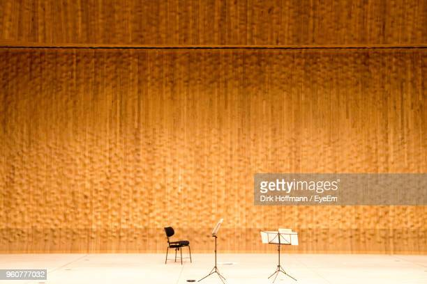 Empty Orchestra Stage Against Orange Backdrop
