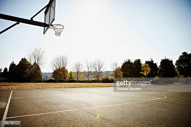 empty outdoor blacktop basketball court - sports court stock pictures, royalty-free photos & images