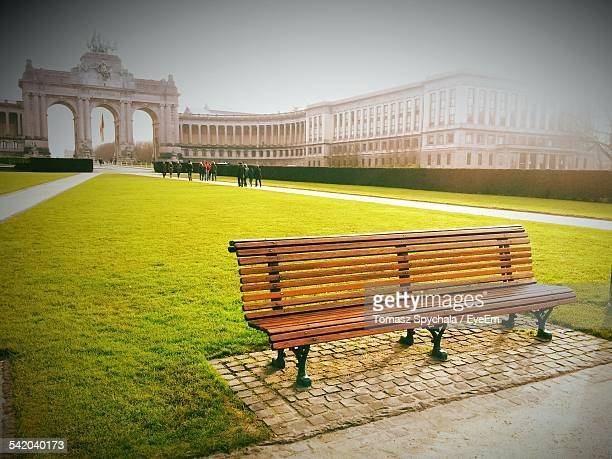 Empty Park Bench In Cinquantenaire Against Clear Sky
