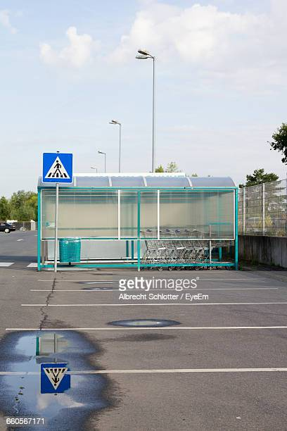 empty parking area against the sky - albrecht schlotter stock photos and pictures