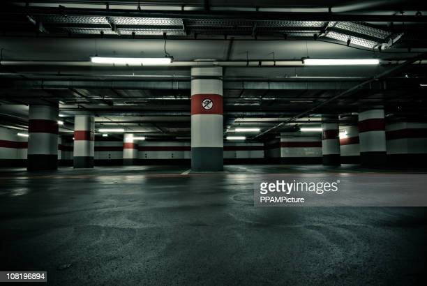 empty parking garage with no smoking sign - parking sign stock photos and pictures