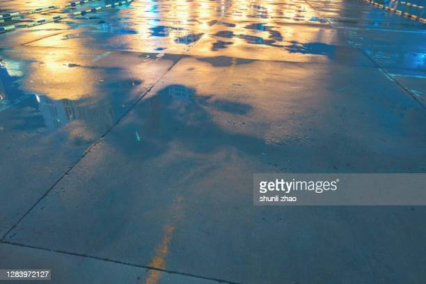 empty parking lot after rain - empty lot night stock pictures, royalty-free photos & images