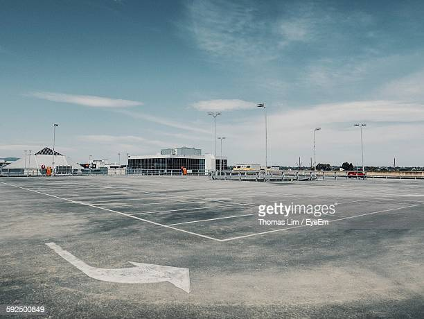empty parking lot against sky - car park stock pictures, royalty-free photos & images
