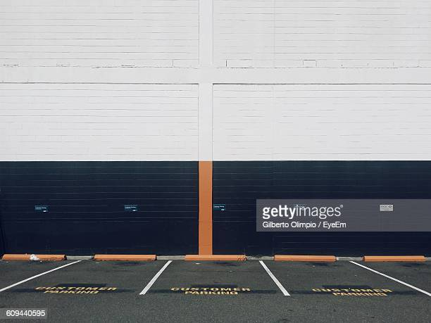 Empty Parking Lot Against Wall