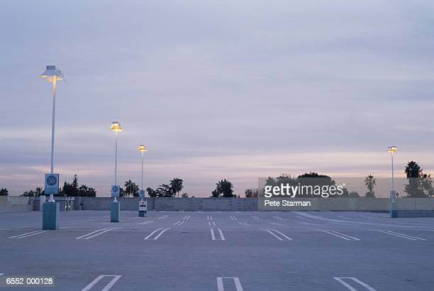 empty parking lot at dusk - car park stock pictures, royalty-free photos & images