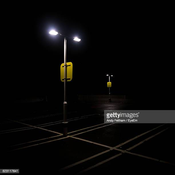 empty parking lot at night - empty lot night stock pictures, royalty-free photos & images