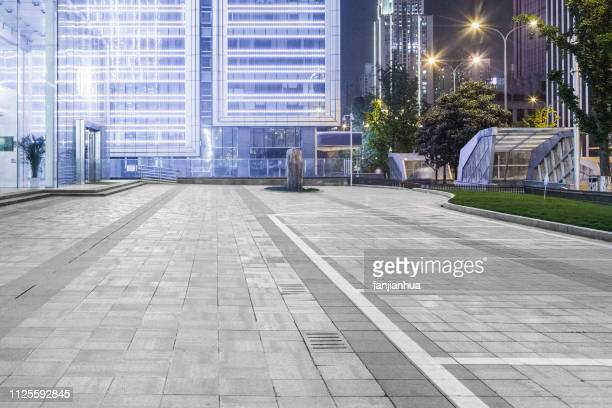 empty parking lot front of modern shopping center - empty road stock pictures, royalty-free photos & images