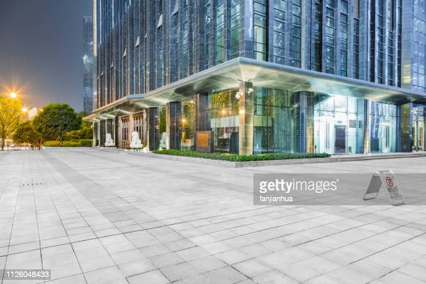 empty parking lot front of modern shopping center - empty lot night stock pictures, royalty-free photos & images