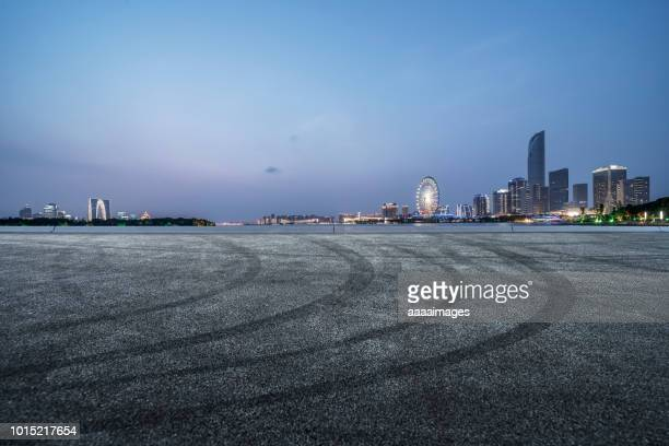 empty parking lot front of suzhou cityscape - empty lot night stock pictures, royalty-free photos & images