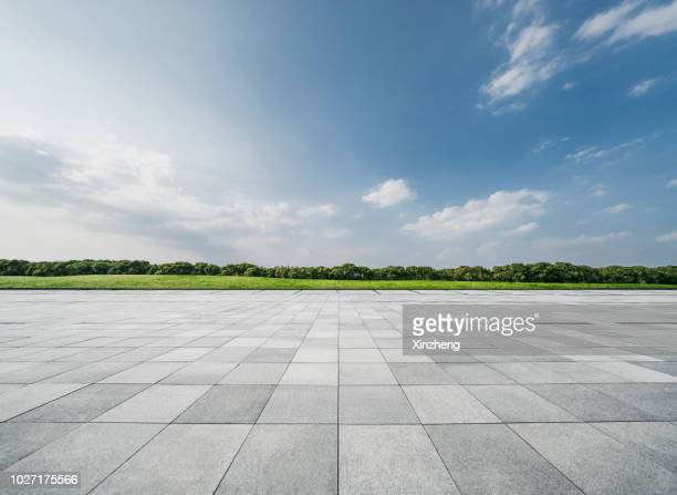 empty parking lot - paving stone stock pictures, royalty-free photos & images