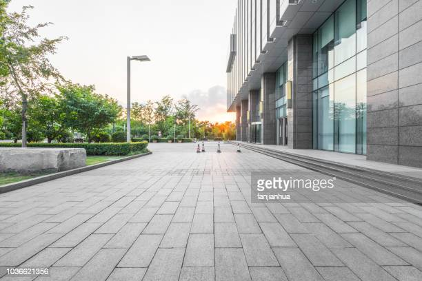 empty parking lot - pavement stock pictures, royalty-free photos & images