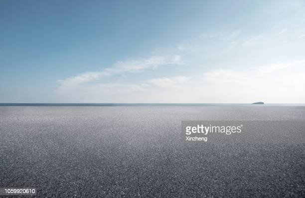 empty parking lot - horizon over land stock pictures, royalty-free photos & images