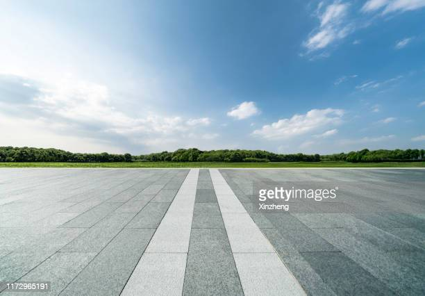 empty parking lot - treelined stock pictures, royalty-free photos & images