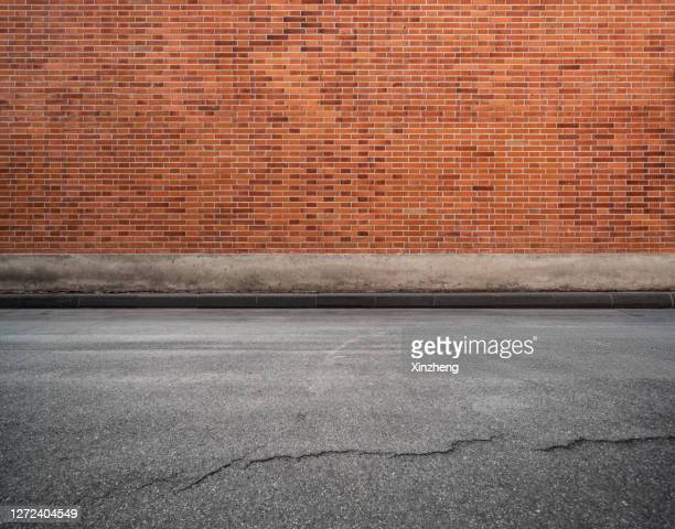 empty parking lot - brick wall stock pictures, royalty-free photos & images