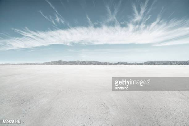 empty parking lot - horizon stock pictures, royalty-free photos & images