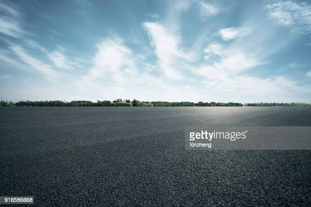 empty parking lot - asphalt stock pictures, royalty-free photos & images