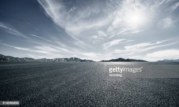 empty parking lot - moody sky stock pictures, royalty-free photos & images