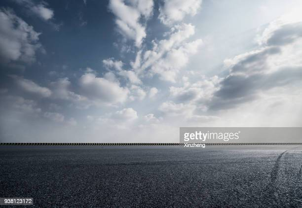 empty parking lot - dramatic sky stock pictures, royalty-free photos & images