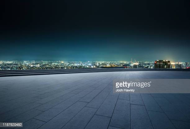 empty parking lot with cityscape background - 様式 ストックフォトと画像
