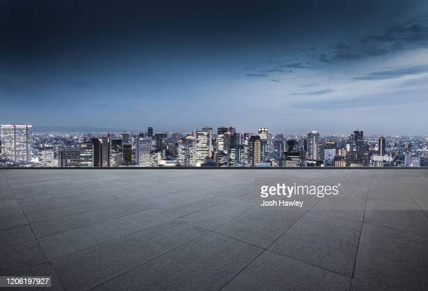 empty parking lot with cityscape background - high dynamic range imaging stock pictures, royalty-free photos & images