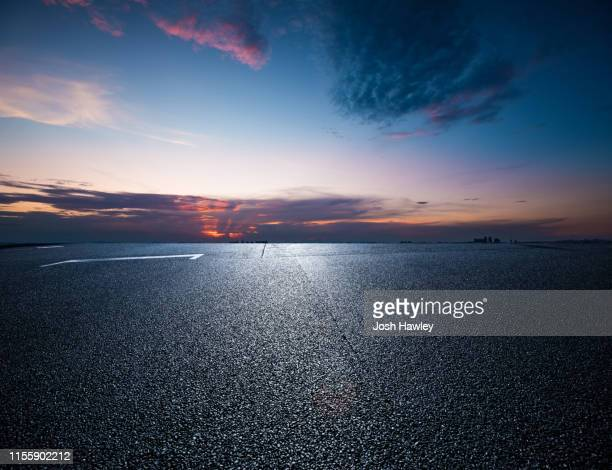 empty parking lot with cloud background - empty lot night stock pictures, royalty-free photos & images