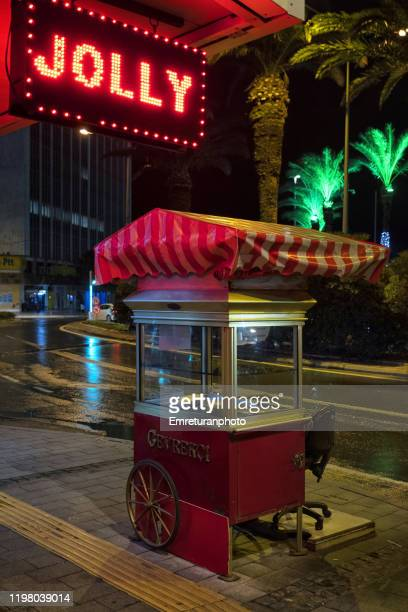 empty pastry vendor cart and illuminated red neon sign at night,izmir. - emreturanphoto fotografías e imágenes de stock