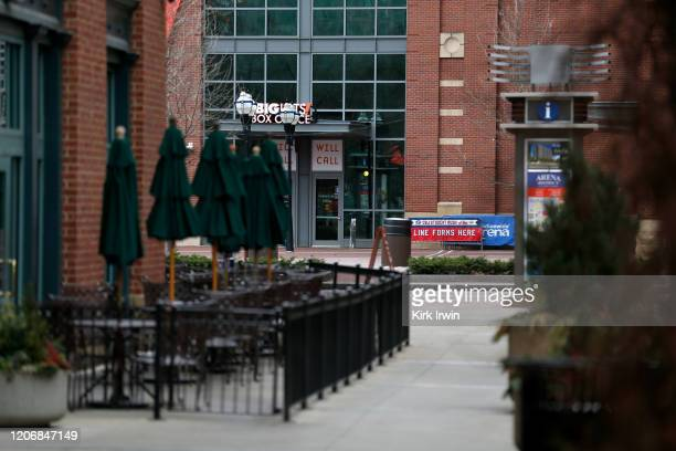 Empty patio tables line a side street leading to a plaza at Nationwide Arena on March 12 2020 in Columbus Ohio The game between the Columbus Blue...