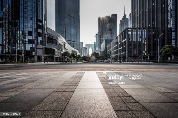 empty pavement with modern architecture - city life stock pictures, royalty-free photos & images